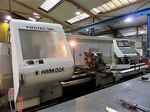 Hankook-Protec-9NC-37-x-157-Flat-Bed-CNC-Lathe-With-9.8-Bore