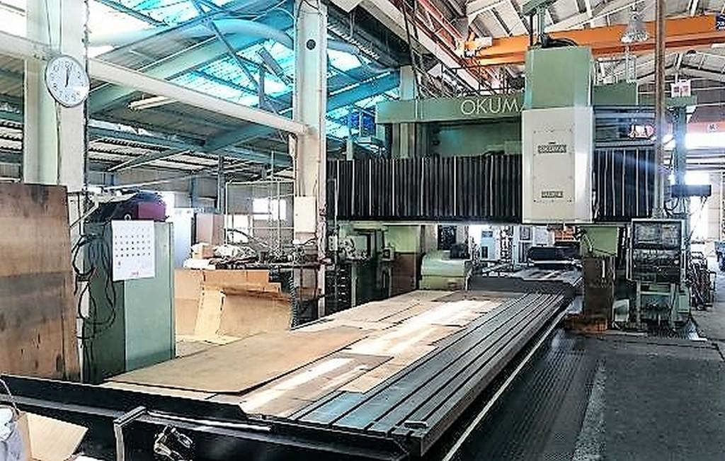 OKUMA-MCR-BII-25x65E-A-5-Face-CNC-Double-Column-Machining-Center